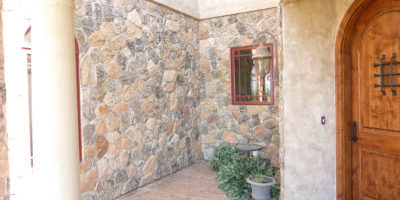 Thin stone veneer, moss rock pattern.